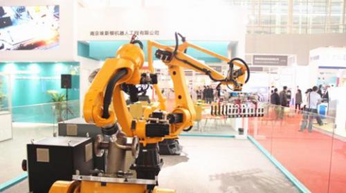 东莞全市智能装备制造 机器人产业链条 以智能化改造为主体的 机器换